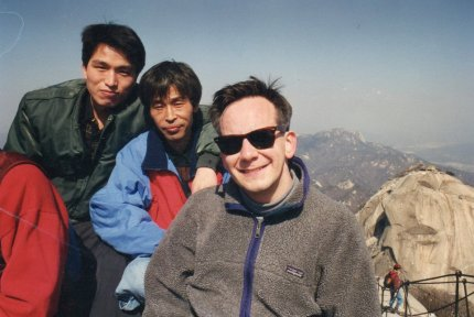 Sam (upper left) - some other guy and I on top of Pukhansan north of Seoul!
